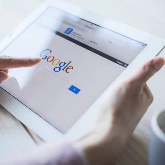 Person on iPad uses Google