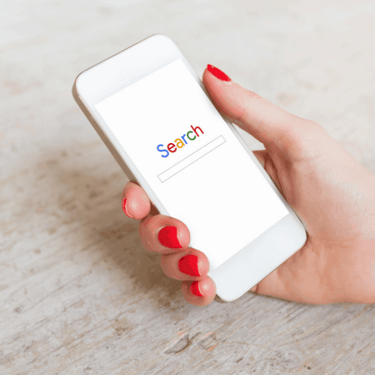 Google image seo woman holding smartphone