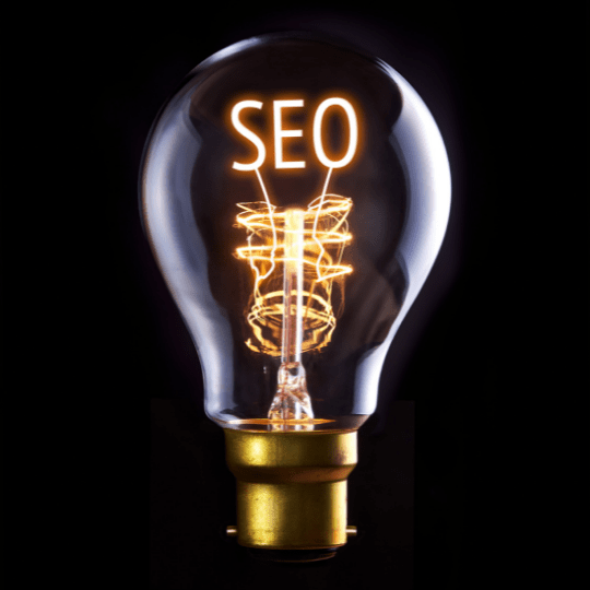 SEO illuminated in lightbulb