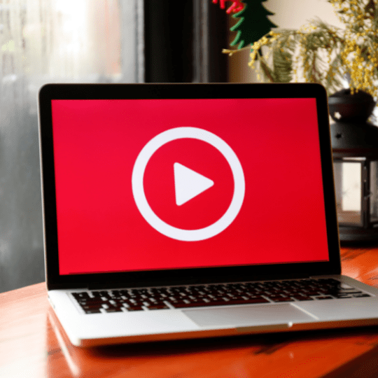 Computer displaying red video SEO play button