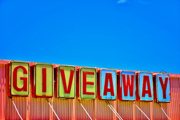 Retro giveaway sign again blue sky background