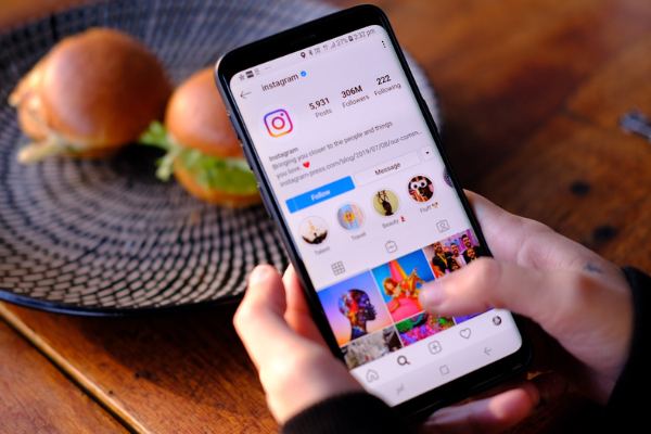 Smartphone displaying colourful Instagram profile