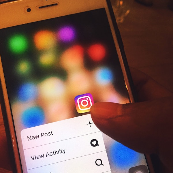 Smartphone displaying Instagram icon with New Post button