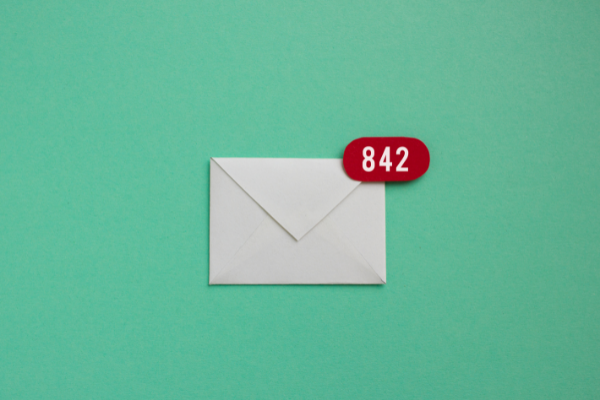 White envelope on green background with email notification symbol