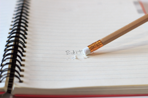 Pencil and eraser marks on notebook